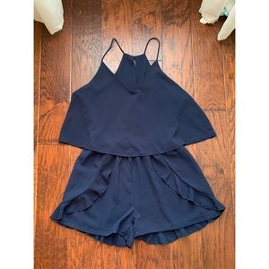 Adeline clothing navy romper with ruffled detail